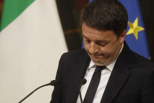 总理在公投中失败请辞 意大利前景不明(图)