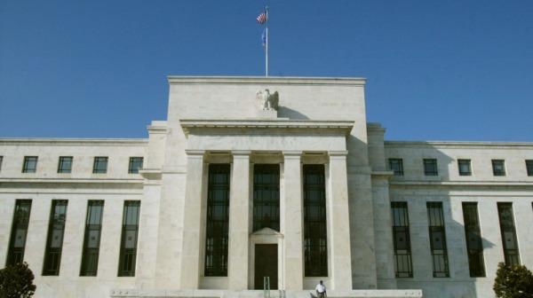 美联储对进一步降息持开放态度 计划扩大债券投资组合(图)